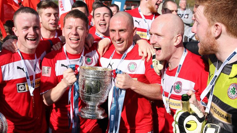 Cliftonville celebrate winning the title for the first time since 1998 (© Scott Media Belfast)