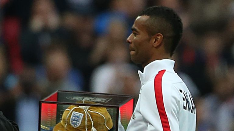 Ashley Cole recieves his golden cap to commemorate his 100th appearance for England