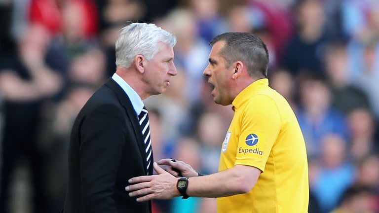 Newcastle manager Alan Pardew speaks to referee Phil Dowd during the Premier League match against West Ham United