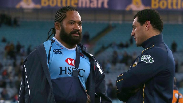 Tatafu Polota-Nau (left) and George Smith: duo speak on the field after Waratahs beat Brumbies