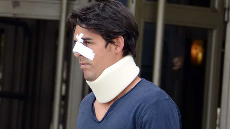 Thomas Drouet leaving court wearing a bandage and neck brace