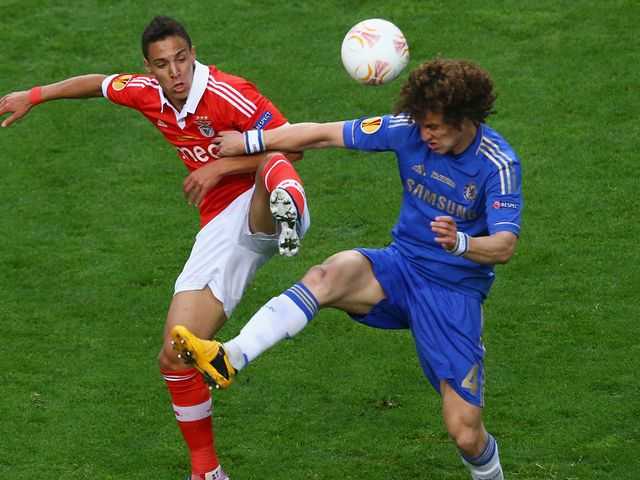 Lorenzo Melgarejo tangles with David Luiz as they battle for possession