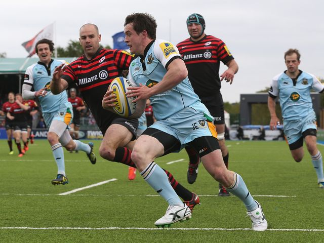 Jamie Elliott goes in for a Northampton try