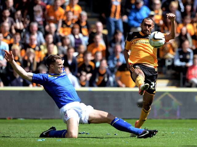 Ahmed Elmohamady clears the ball as Ben Turner closes in.