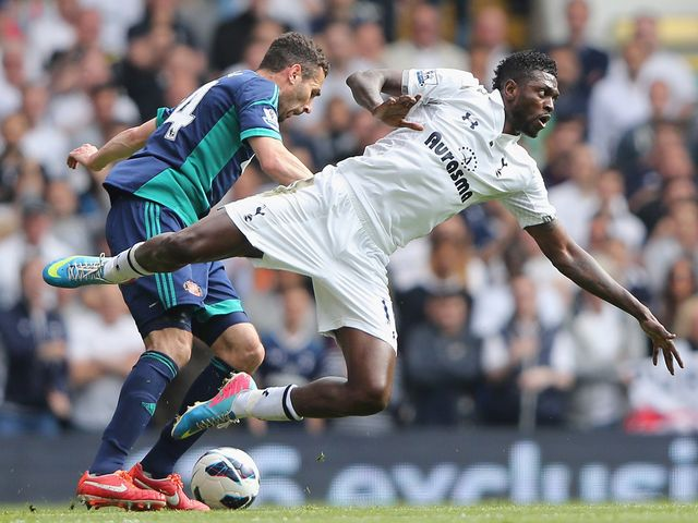 Emmanuel Adebayor takes a tumble.