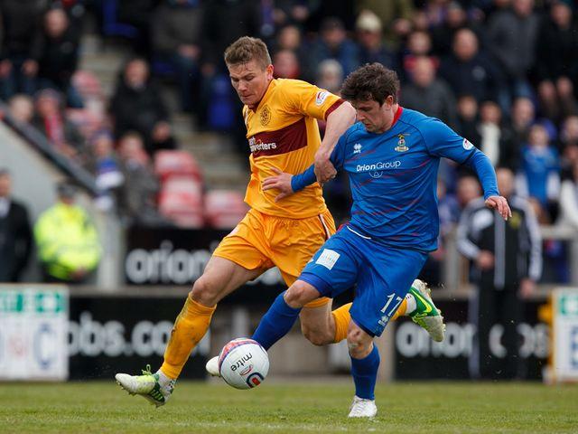Shaun Hutchinson tackles Aaron Doran.