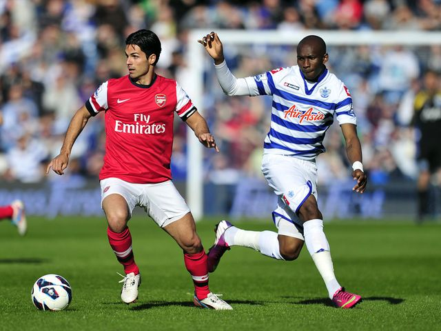 Mikel Arteta vies with Stephane Mbia.