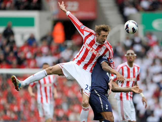Peter Crouch feels he's fouled by Tom Huddlestone
