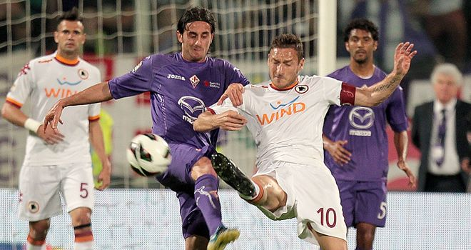 Fiorentina's Alberto Aquilani battles with Francesco Totti