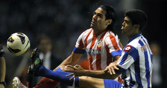 Atletico Madrid's Radamel Falcao (L) vies with Aythami