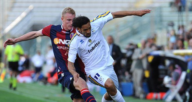 Carvalho de Oliveira Amauri is tackled by Frederik Sorensen