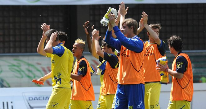 Chievo applaud their fans at the final whistle