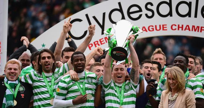 Celtic captain Scott Brown lifts the Scottish Premier League trophy