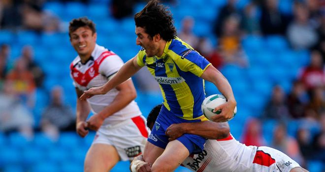 Warrington's Stefan Ratchford is tackled by Sia Soliola