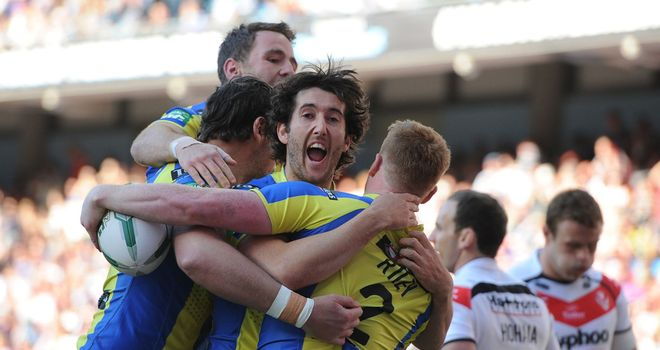 Warrington celebrate one of eight tries against St Helens