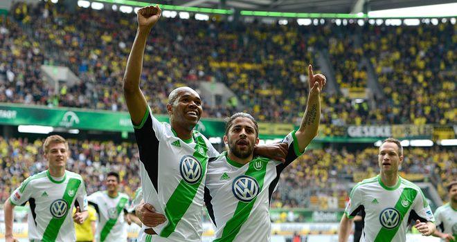 Wolfsburg's Naldo and Ricardo Rodriguez celebrate