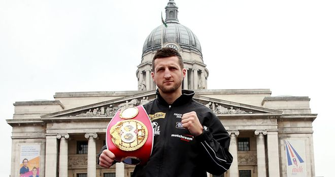Carl Froch: Poses with his IBF belt in Nottingham's Market Square on Monday