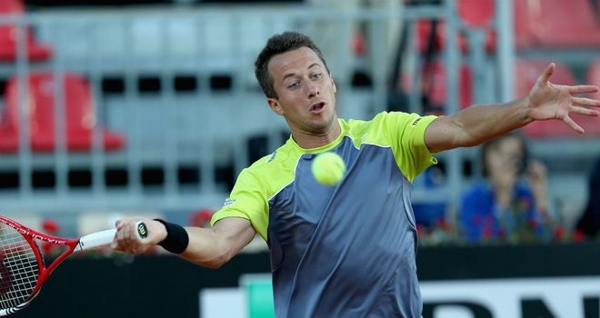 Philipp Kohlschreiber: Through to the second round with a straight sets win over Milos Raonic