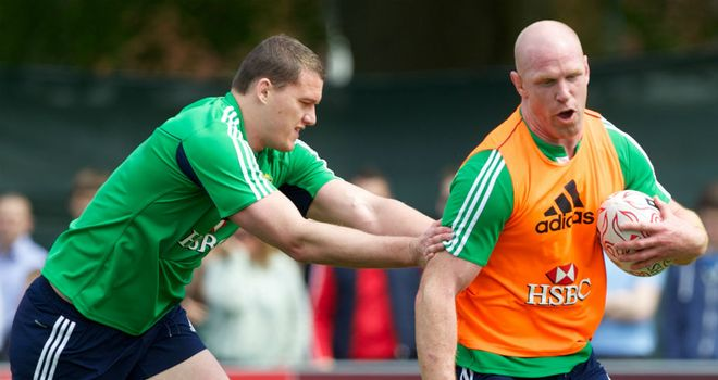 Paul O'Connell is caught by Ian Evans during training