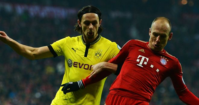 Neven Subotic locks horns with Arjen Robben earlier in the season