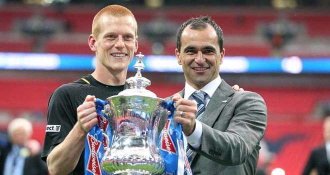 Ben Watson: Lifts the FA Cup with Wigan manager Roberto Martinez