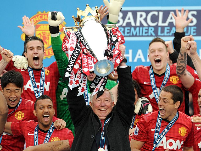 Sir Alex Ferguson lifts the Premier League trophy at Old Trafford