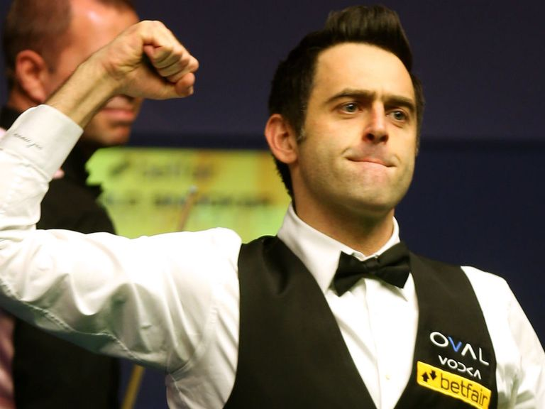 Ronnie O'Sullivan celebrates his victory.