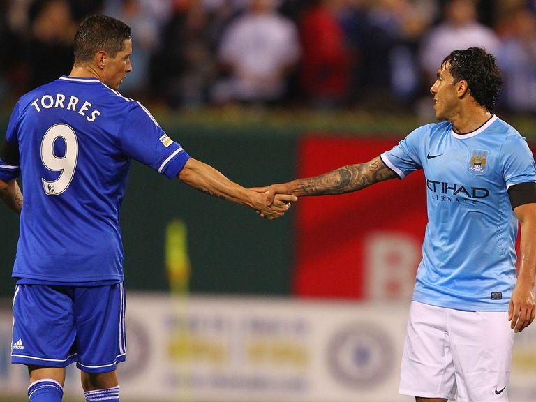 Fernando Torres shakes hands with Carlos Tevez.