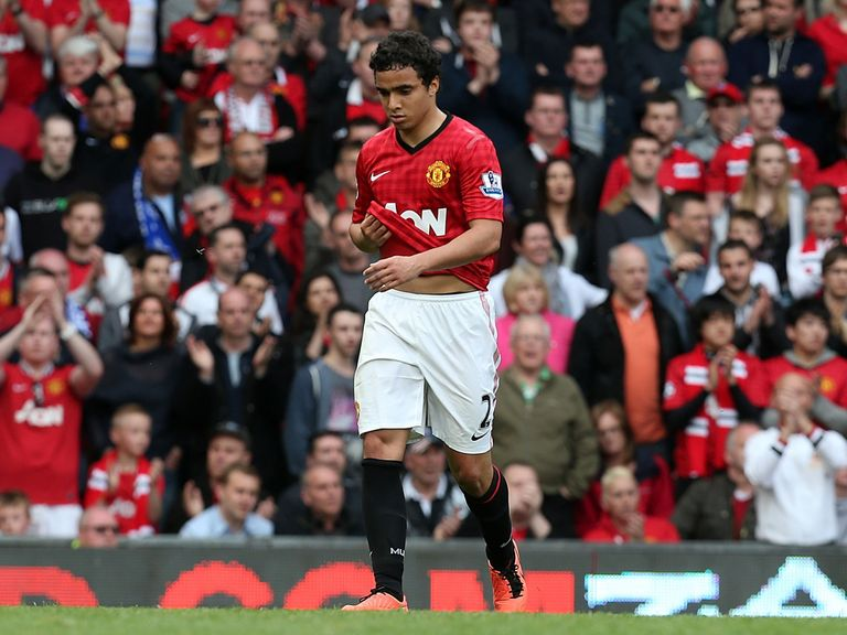 Rafael makes his way off the field after his red card.