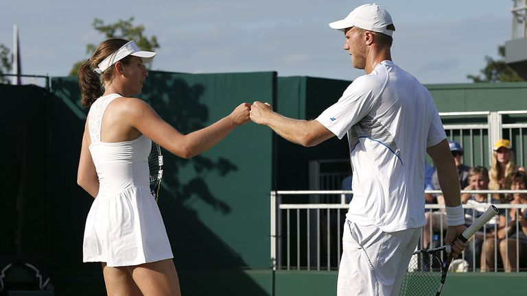 Dominic Inglot and Johanna Konta celebrate a point during their marathon mixed doubles encounter on Saturday