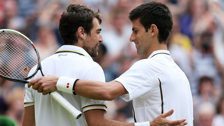 Novak Djokovic (r) and Jeremy Chardy shake hands at the end of their one-sided match on Centre Court