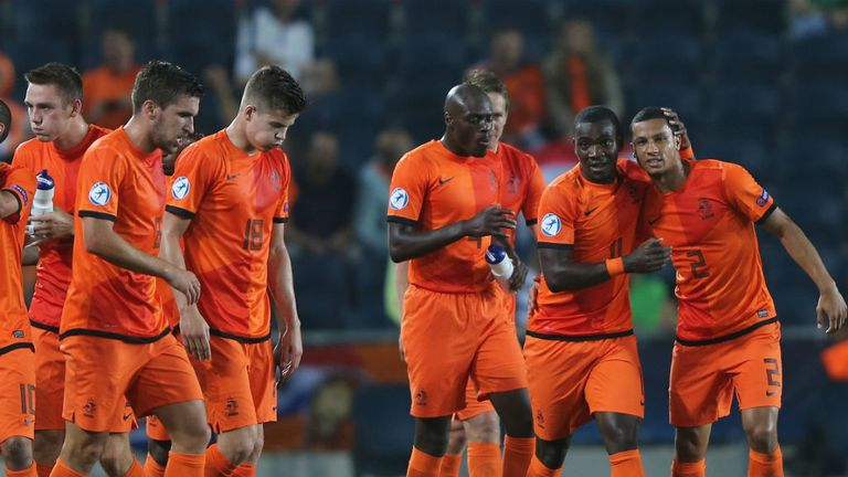 Holland celebrate after Ola John makes it 3-1 against 10-men Russia