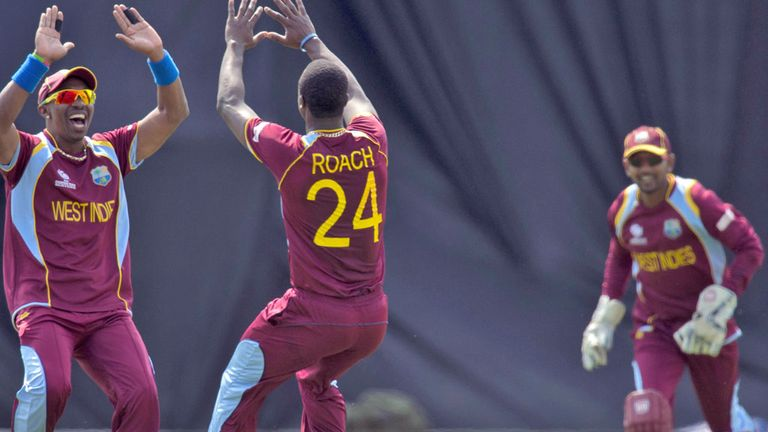 West Indies, with Ramdin in background, celebrate after Misbah 'catch'