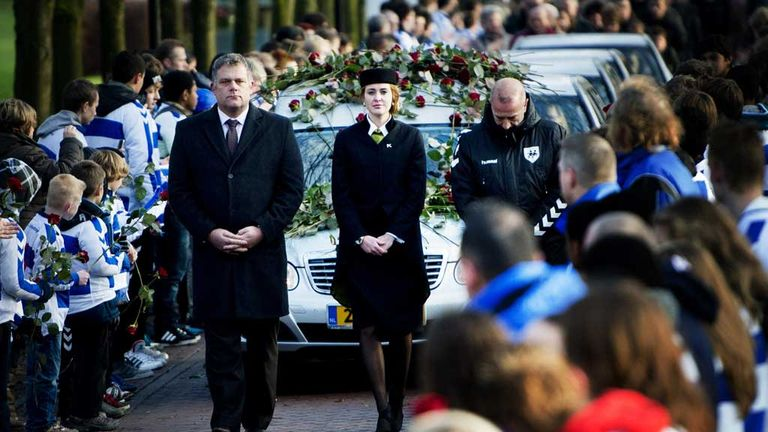 Members of SC Buitenboys lay roses on the hearse carrying Richard Nieuwenhuizen