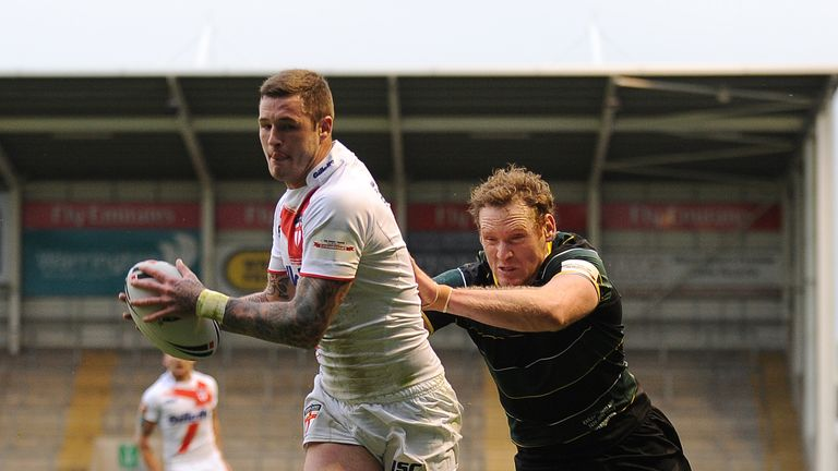 Too strong: Exile's Joel Monaghan fails to stop England's Zak Hardaker from scoring the opening try at the Halliwell Jones Stadium