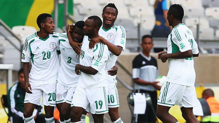 Uwa Elderson Echiejile: Celebrates after scoring the opening goal
