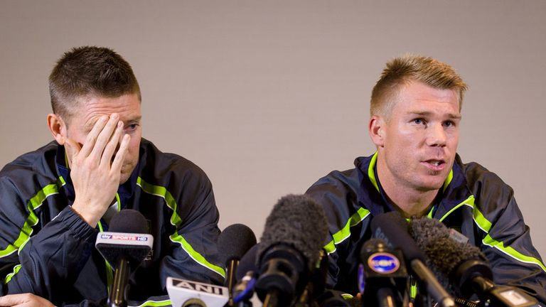 Clarke and Warner: facing the world's media as the fall-out rumbles on