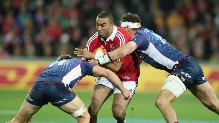 Simon Zebo is tackled by Mitch Inman and Lachlan Mitchell