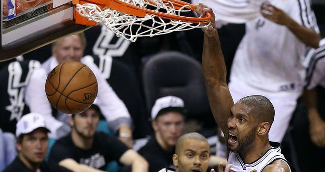 Tim Duncan celebrates his slam dunk