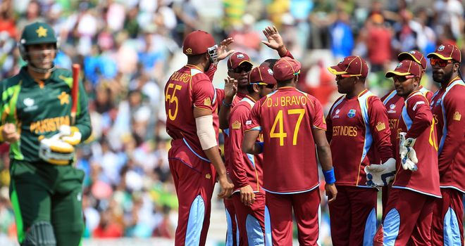 West Indies celebrate before Misbah is called back after review