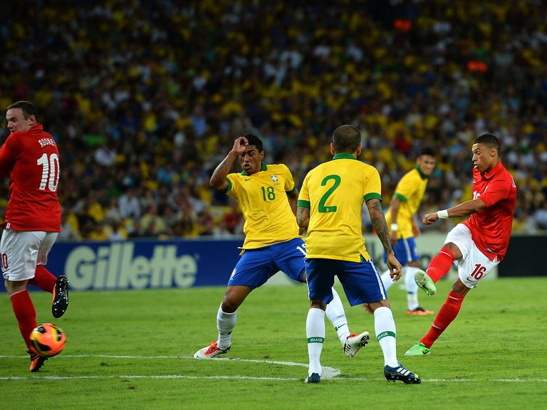 Alex Oxlade-Chamberlain scores against Brazil.