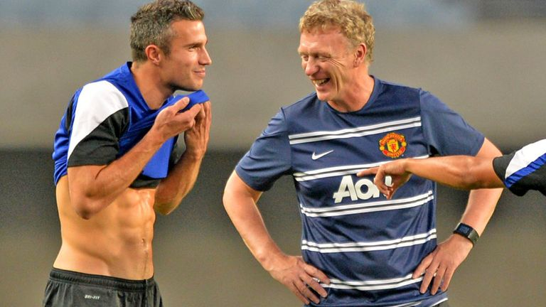 David Moyes enjoys a joke in training with Robin van Persie