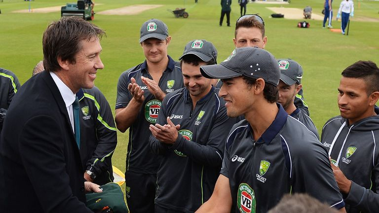 Ashton Agar receives his Baggy Green from Glenn McGrath