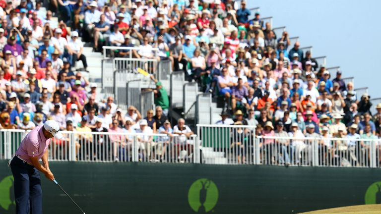 The Muirfield crowd looks on as Sergio Garcia putts