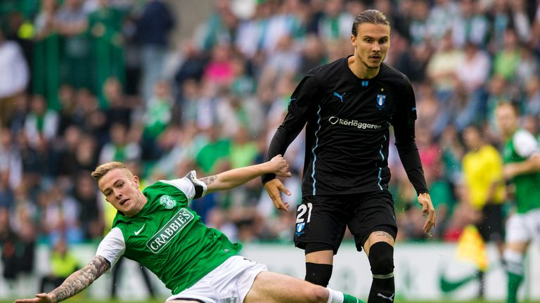 Hibs' Danny Handling battles with Malmo's Erik Jansson.