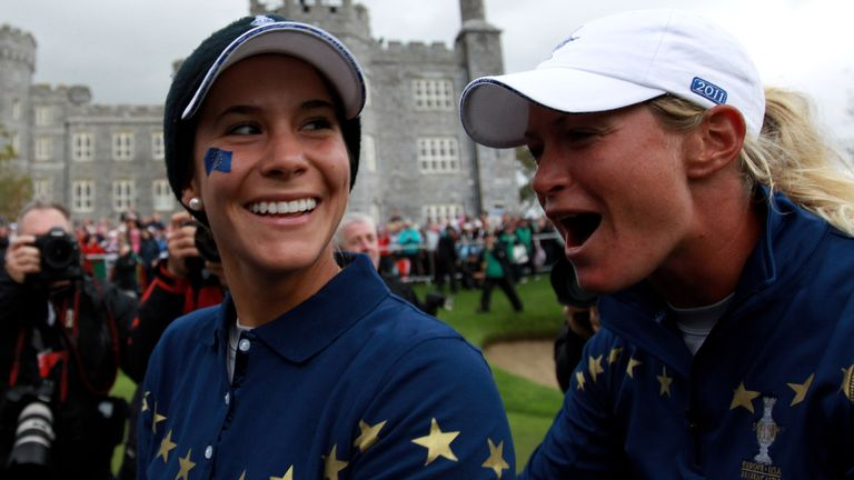 Azahara Munoz and Suzann Pettersen celebrate their team's dramatic 15-13 victory