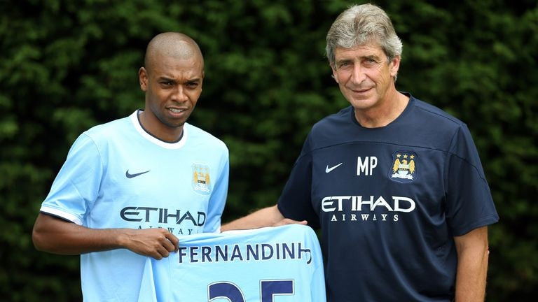 Fernandinho & Pellegrini: City are under the radar, says Neville, who is surprised by lack of big deals