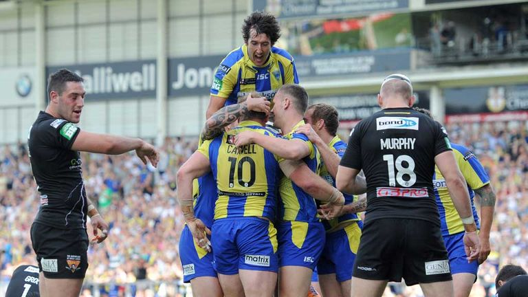 Warrington players celebrate a try against Huddersfield