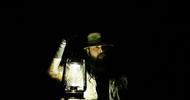 Shadow person: Bray Wyatt emerges from the darkness with his lantern in tow