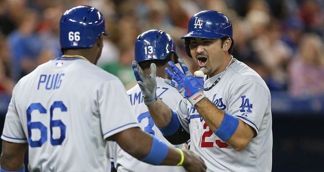 Adrian Gonzalez celebrates scoring for the Los Angeles Dodgers